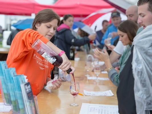 A vendor pours wine for customers at the Gettysburg Wine and Music festival on September 12th, 2015.