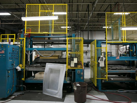 A vacuum forming machine at Faro Industries in Rochester. Faro built most of the machines that they now use to fabricate plastic parts.
