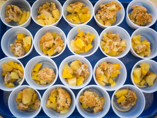 Taste test samples of the apple-squash crisp. Visitors, including Pennsylvania Department of Agriculture Secretary Russell C. Redding and Rep. Mike Regan, R-Carroll Township, take a tour of Northern High School's Farm to School program, Friday, October 23, 2015.