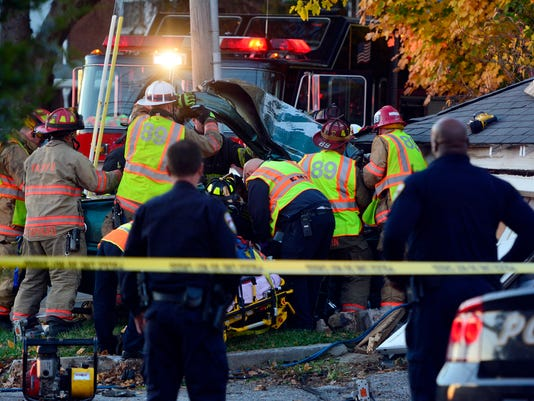A police chase in Spring Garden Township ended with the suspect vehicle crashing into a garage, Sunday, Nov. 8, 2015. John A. Pavoncello - jpavoncello@yorkdispatch.com
