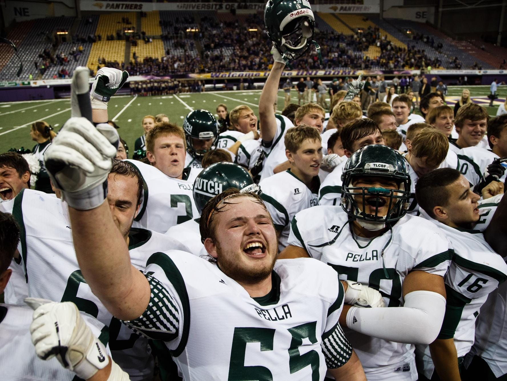 Pella celebrates its 3A state title victory over Norwalk at the UNI-Dome in Cedar Falls on Thursday. The Dutch finished the season at 14-0.
