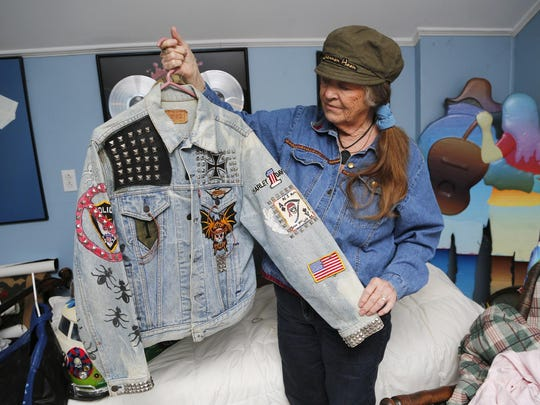 Nel Hoon displays the jacket worn by her late son, Shannon Hoon, when he was in the local band Styff Kytten.