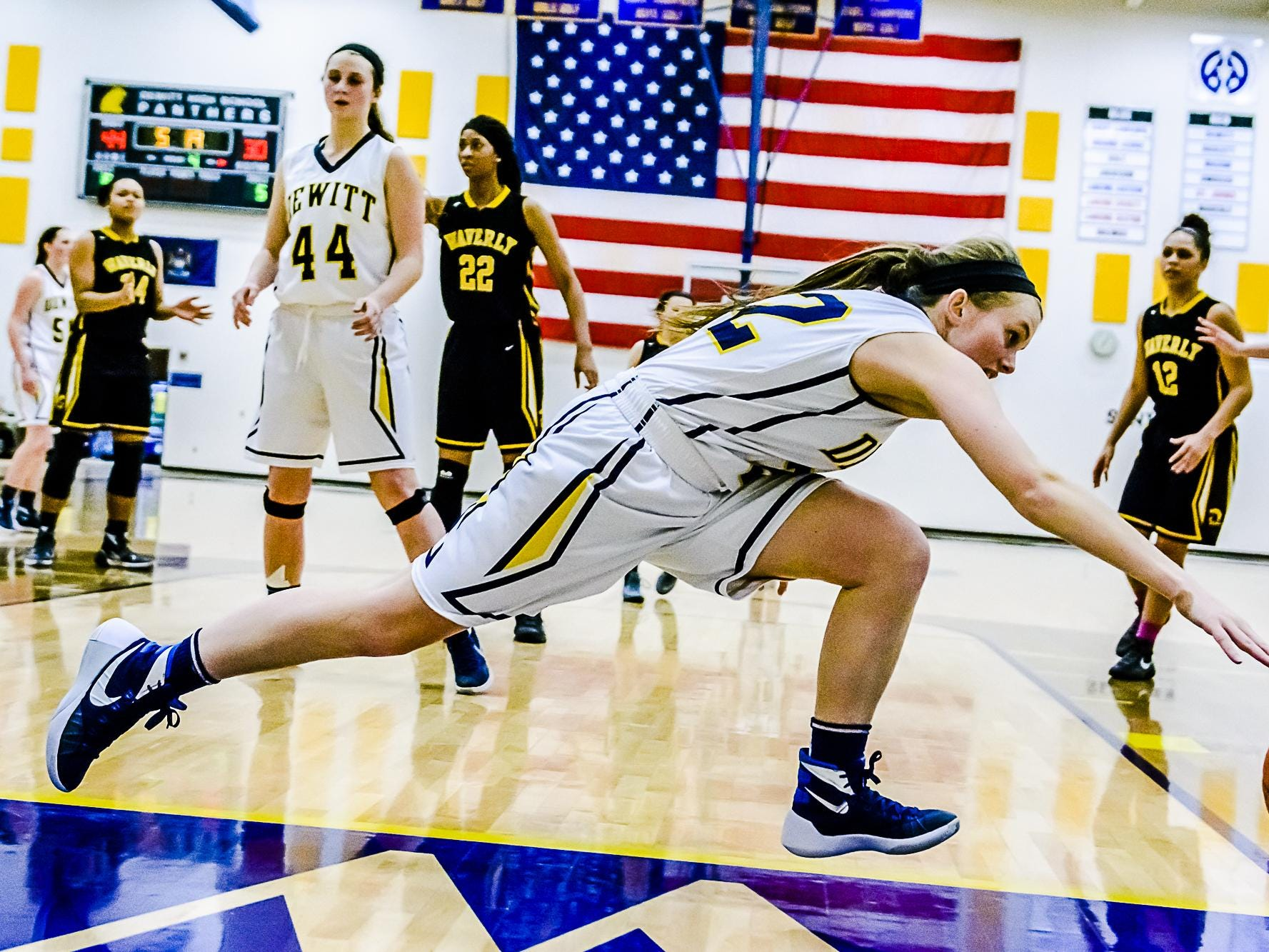 Jessah McManus of DeWitt chases a loose ball out of bounds during the Panthers' game with Waverly Friday February 12, 2016 in DeWitt. KEVIN W. FOWLER PHOTO