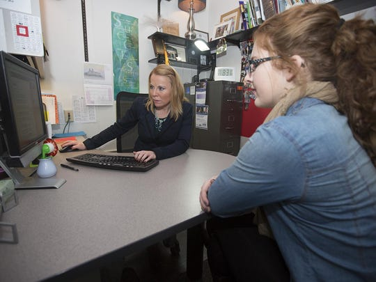 Guidance counselor Valerie Fetting, left, helps senior Rachel Keiffer, 18, find out upcoming placement testing times at Stevens Point Area Senior High School, Monday, Feb. 1, 2016.
