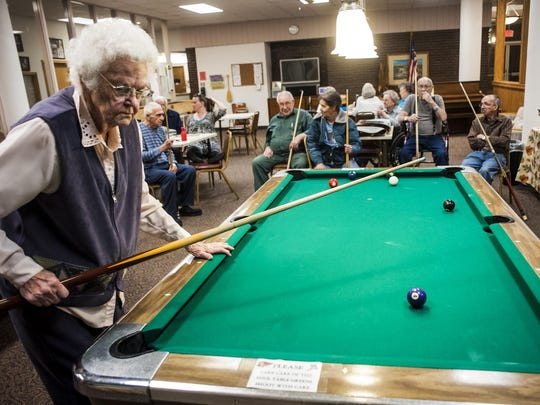 """Leah Walbon competes in a pool tournament at the Eagles Manor last week. She will turn 100 on March 1 and has played pool since 1981 when she retired from her job at Safeway. """"When I play pool, I have my mind set to do this and that,"""" she said, emphasizing the importance of concentration."""