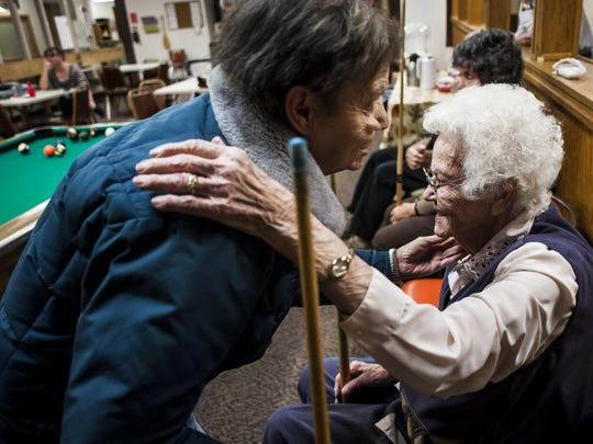 Leah Walbon, right, greets Marie Pfliger, left, during a pool tournament at the Eagles Manor Tuesday, Feb. 16, 2016. Walbon will turn 100 on March 1st and has played pool since 1981 when she retired from her job at Safeway.