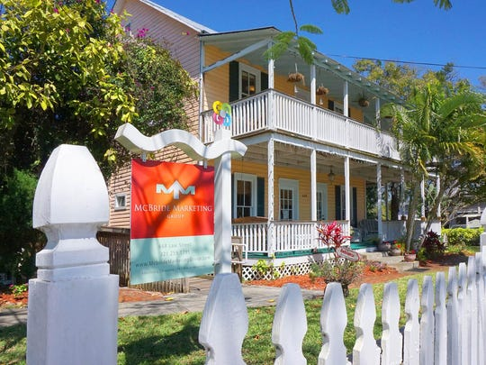Located at 668 Law St., McBride Marketing Groups works out of this 106-year-old Florida-style house. Wrap-around porches and a backyard swimming pool really make the employees feel at home.