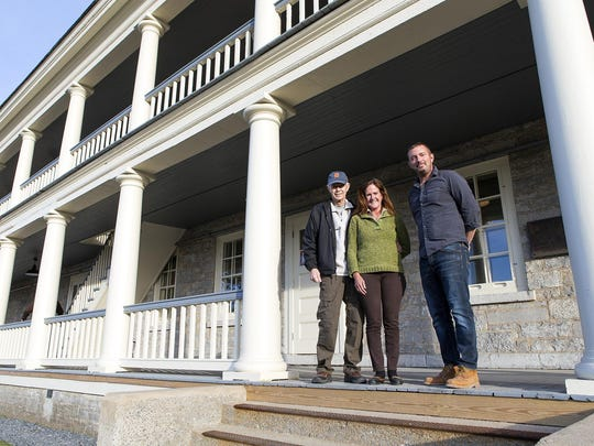 Valcour Brewing Company owners Terry Schmaltz and Mary Pearl, along with brewmaster and executive chef Rob Davis, outside the historic Old Stone Barracks built in 1838 which now houses their brewery, and a bed and breakfast, general store, events space and a second tasting area that is scheduled to open soon.