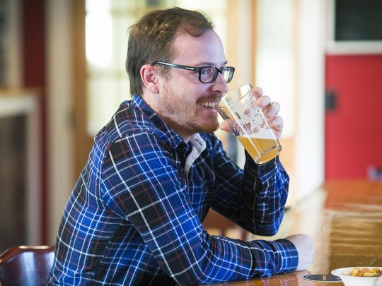 Thomas Montanaro of Ausable Chasm enjoys a pint of Holden's Golden, a golden rye ale, which is their lightest offering featuring a slightly nutty malt flavor with a touch of hop bitterness.