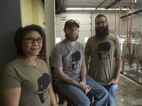 Cindy DeRama, Scott McLuskey and Tim Bescker are the three owners of Twin Elephant Brewing Company in Chatham.