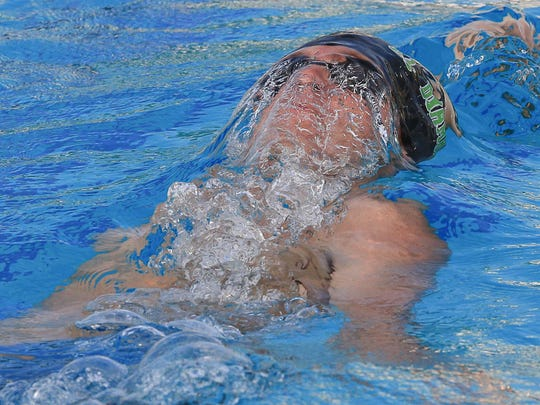 El Diamante's Callen Bruening swims to first place in the 100-yard backstroke.