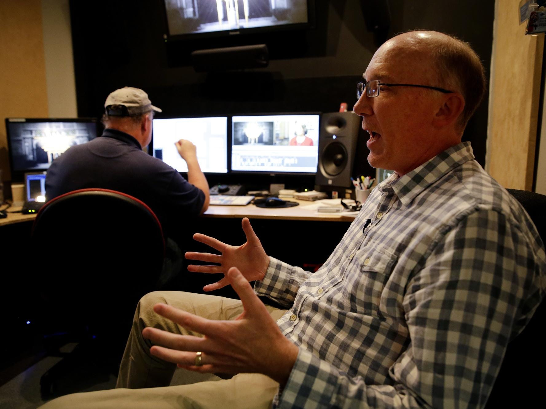 Ted Green, who is writing and producing a documentary about the historic Crispus Attucks High School, talks about the project inside a production studio at WYFI alongside editor Pete Saetre on April 22, 2016.