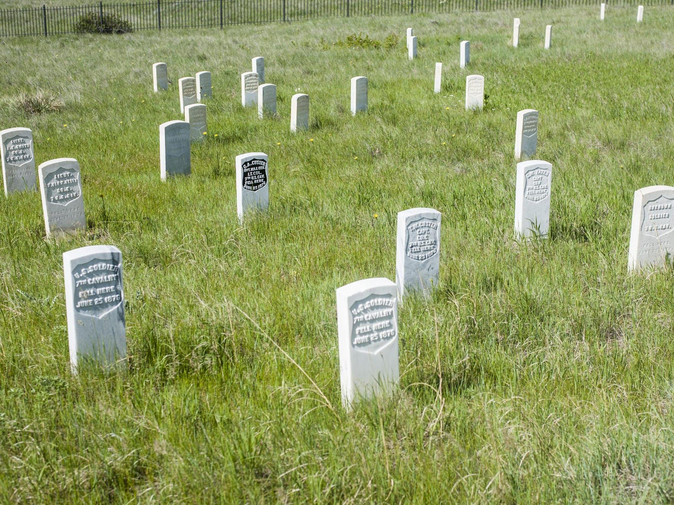 The spot where General George Custer fell is marked in black at Last Stand Hill on the Little Bighorn Battlefield.
