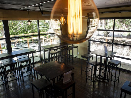 Large light bulbs illuminate interior design by Marty Balus at Bunkhouse Brewing in Bozeman.