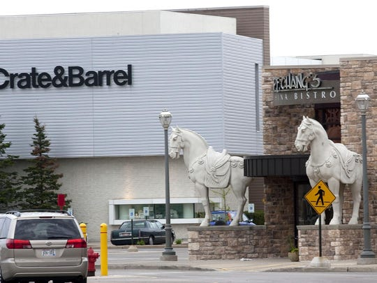 File photo of Crate & Barrel and P.F. Chang's businesses seen in the parking lot of Mayfair Mall in 2013.