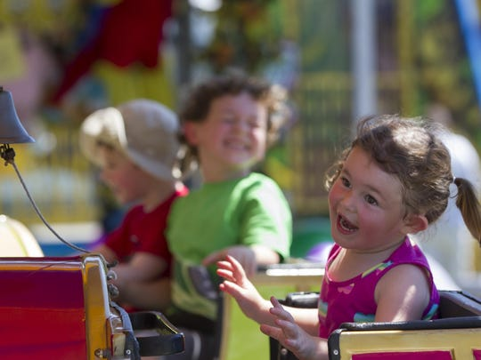 Makenzie Fleres of Chester clowns around while she rides an amusement at MorrisCounty 4-H Fair. The Morris County 4-H Fair is a chance to showcase and celebrate the many achievements of Morris County 4-H members. This wholesome family event includes live music, food, rides, science exhibits, club activities, hay rides, and plenty of animals, including bunnies, goats, chickens, horses and pigs. The event is held through Sunday at Chubb Park, Chester, NJ. Saturday, July 23, 2016.