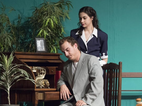 "Michael Seitz and Leiana Petlewski rehearse a scene from Visalia Players production of the comedy ""Arsenic and Old Lace."""