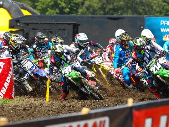 Joey Savatgy (37) grabs the holeshot at the start of the 250 moto.