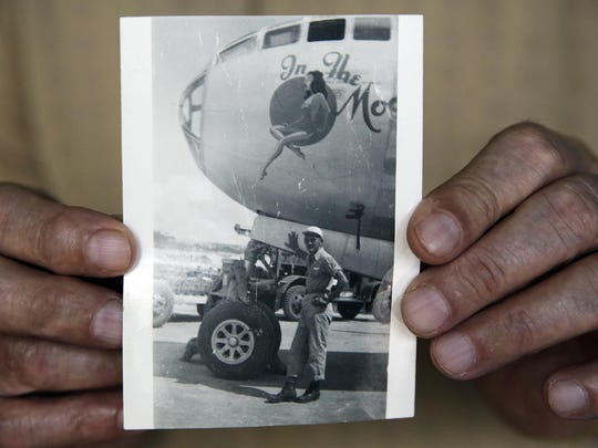 World War II veteran Harold Leavitt, 94, is shown in a photograph standing in front of his B-29 during the war.