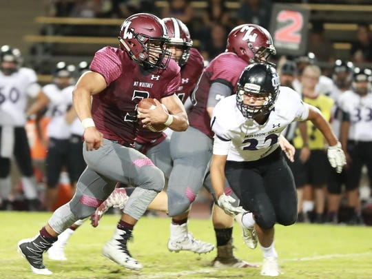 Mt. Whitney running back Adam De La Torre rushes for