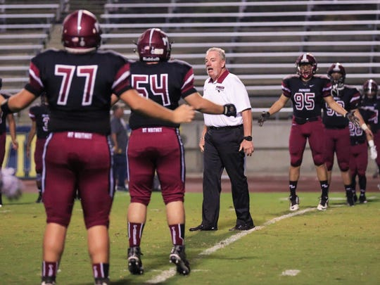 Mt. Whitney's Marty Martin directs players during pre-game warmups.