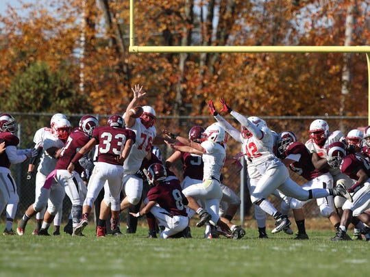 Dunellen blocks an extra point in Saturday's game versus South River.