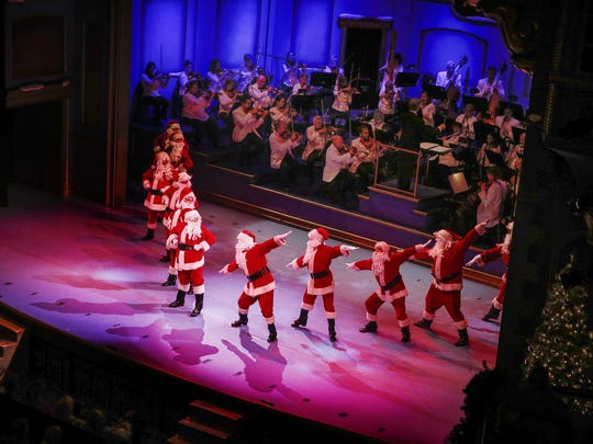 Tap dancing Santa's entertain the crowd during the