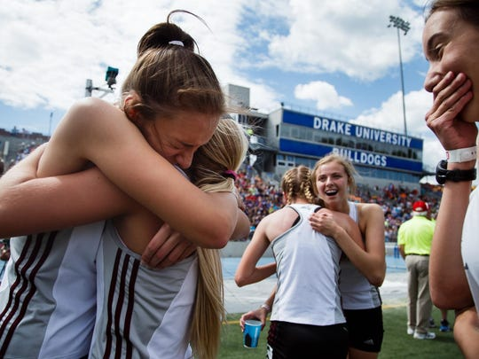 Hannah Draayer, left, hugs teammate Sydney Reysack after Ankeny Centennial won the girls' distance medley relay at the Class 4A state track meet on May 20 at Drake Stadium. The Jaguars posted a time of 4:05.21 to edge Waukee by .04 seconds.