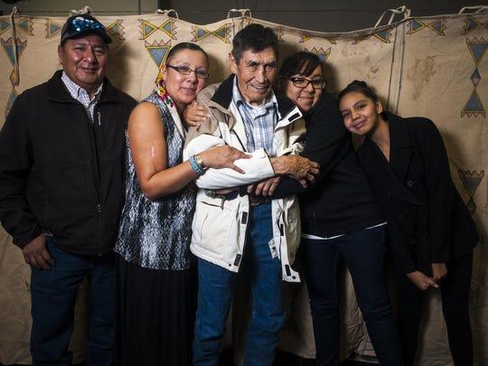 Belinda Bullshoe, second from left, thanks her family