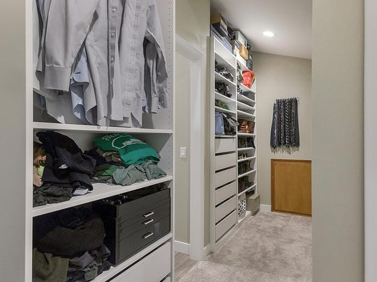 Custom shelving allows for wall-to-wall storage, keeping closet spaces neat and organized.