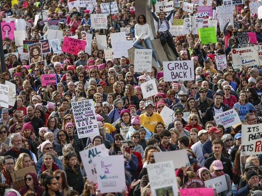 Thousands attend the Women's March Indianapolis rally, a sister rally of the Women's March on Washington, on the west side of the Indiana Statehouse in Indianapolis in January 2017.
