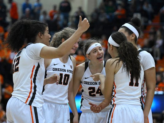 FILE--In this Jan. 29, 2017, file photo, Oregon State huddles with less than a minute to play against Oregon in an NCAA college basketball game in Corvallis, Ore. Stanford's loss at home to UCLA Monday, Feb. 6, 2017, popped Oregon State into sole possession of the top spot in the league standings at 11-1 in the Pac-12 conference. (Anibal Ortiz/The Gazette-Times via AP, file)