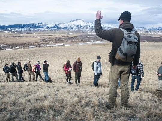Nathan Birkeland lectures on landscape features and environmental conservation methods for a geography field study class Saturday, Feb. 18.
