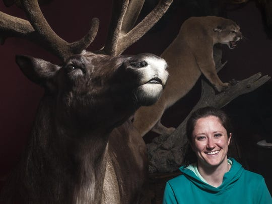Katie Rogers, president of the Montana Taxidermists Association, stands with her award winning Caribou in the Rogers Taxidermy showroom.