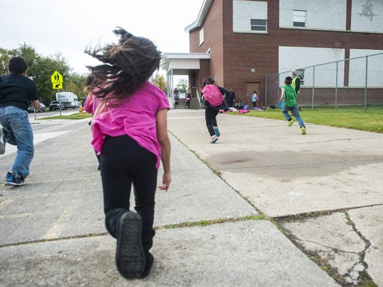 Students play outside Longfellow Elementary, which is being replaced.