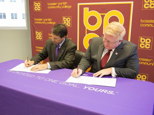 NSU Acting President Dr. Chris Maggio and BPCC Chancellor Dr. Rick Bateman, Jr. sign the updated agreement.