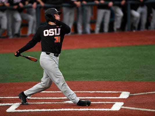 Oregon State's Adley Rutschman drives in a run against Yale during the first inning of an NCAA college baseball tournament regional game Saturday, June 3, 2017, in Corvallis, Ore. (Anibal Ortiz/The Corvallis Gazette-Times via AP)