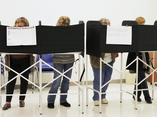 Voters complete ballots at the Horseheads Town Hall in 2013.