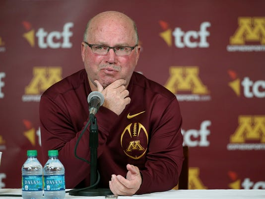 FILE - In this Oct. 28, 2015, file photo, then-University of Minnesota NCAA college football coach Jerry Kill becomes emotional as he speaks during a press conference in Minneapolis.  Jerry Kill has been seizure-free for almost a year and a half. The former Minnesota coach still needs medication to treat his epilepsy and control the seizures that forced him to leave coaching during the 2015 season, but lifestyle changes have been an important part of facing down his condition. Kill has returned to coaching as offensive coordinator with Rutgers.  (Elizabeth Flores/Star Tribune via AP, File)