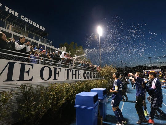 Morris Catholic fans spray the boys soccer players with sparkling cider after winning the NJSIAA Non-Public B final.