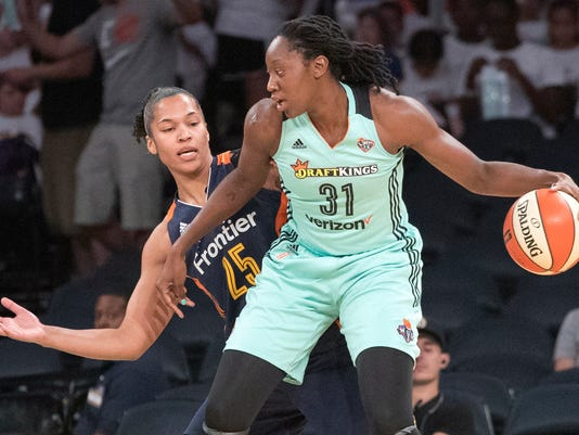 FILE - In this July 19, 2017, file photo, New York Liberty center Tina Charles (31) drives to the basket against Connecticut Sun forward Alyssa Thomas (25) during the first half of a WNBA basketball game in New York. Charles, who is from New York, has made it clear she does not want to leave her hometown. (AP Photo/Mary Altaffer, File)