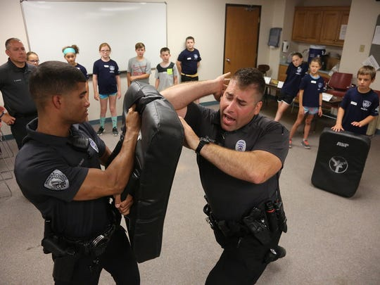 Indianola Police Devin Thomas holds the pad as officer