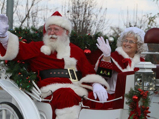 Santa and Mrs Claus wave to the crowd during a past Mauldin Christmas parade.