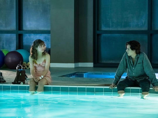 "Stella (Haley Lu Richardson) and Will (Cole Sprouse) in ""Five Feet Apart."""