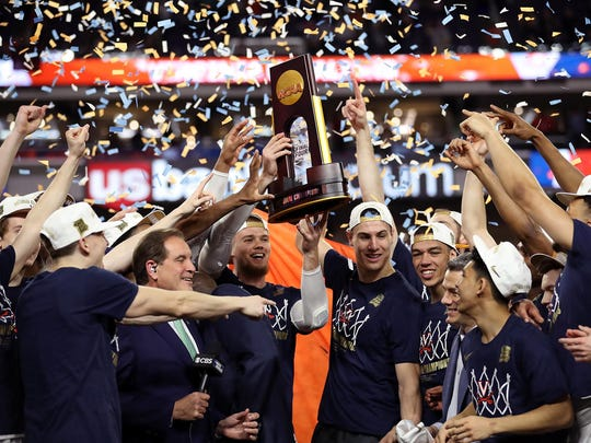 The Virginia Cavaliers celebrate with the trophy after their 85-77 win over the Texas Tech Red Raiders during the 2019 NCAA men's Final Four National Championship game at U.S. Bank Stadium on April 8, 2019 in Minneapolis, Minn. (Streeter Lecka/Getty Images/TNS)