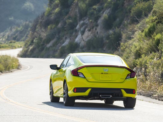 The 2019 Honda Civic Coupe Sport's restyled lower bumper gives Civic a wider look and is complemented by a blacked-out headlight treatment.
