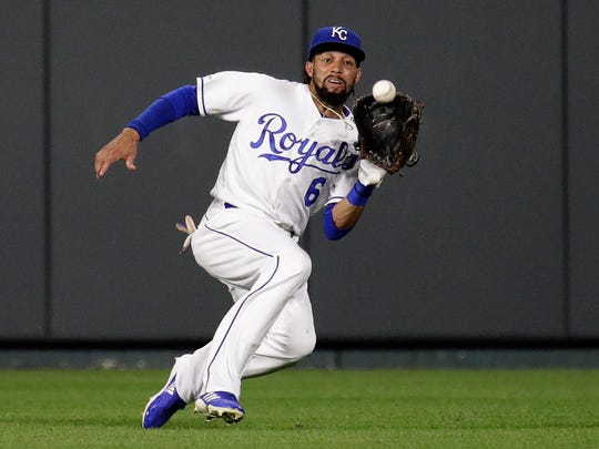 Kansas City Royals center fielder Billy Hamilton catches a fly ball for the out on Cleveland Indians' Jake Bauers during the eighth inning of a baseball game, Thursday, July 25, 2019, in Kansas City, Mo. (AP Photo/Charlie Riedel)
