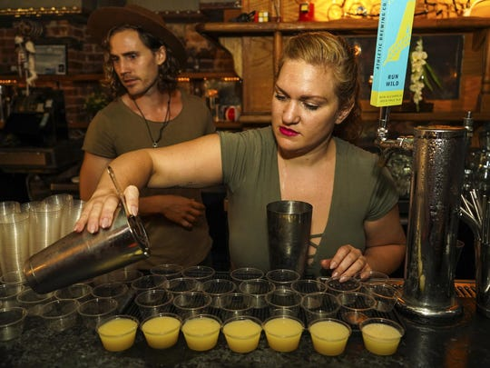 Bartenders Matthew Bray, left, looking on while Crystal Chasse preparing mocktails at Listen Bar in New York. Alcohol-free bars serving elevated mocktails are attracting more young people than ever before. Regular bars and restaurants are cluing into the idea that alcohol-free customers want more than a splash of cranberry with a spritz. The interest is also driven by the wellness movement and higher quality ingredients.