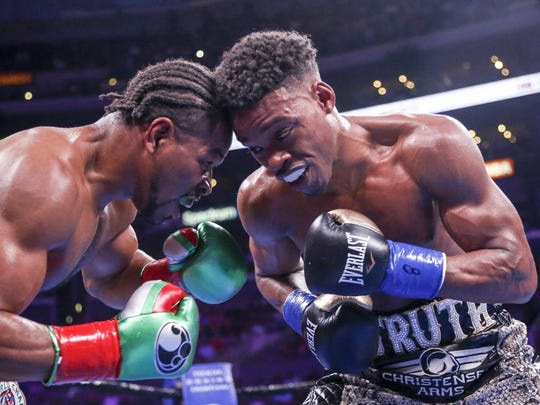 Shawn Porter (left) and Errol Spence Jr. gave everything they had in their memorable welterweight title fight. AP Photo / Ringo H.W. Chiu