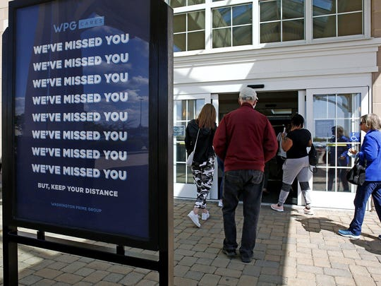 Long-denied shoppers enter the Polaris Fashion Place mall on May 12 as Ohio retailers were allowed to reopen for the first time in nearly two months due to the coronavirus pandemic.